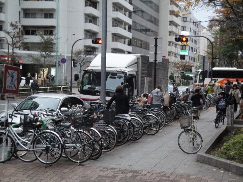 Just a few bicycles parked along the sidewalk in Harajuku.