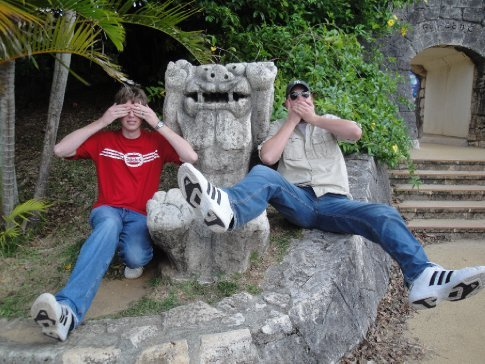 Goofing around in Okinawa with Shisa