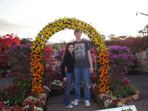 Brandon and I under a flowery arch on January 1st!  No snow, but beautiful flowers!