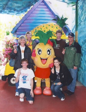 The family with the Pineapple Park mascot.