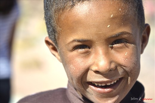 I am Happy regardless of anything. Bedouin kid in the desert