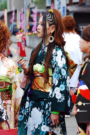 A snapshot during Coming of Age Ceremony, hiphop girl in beautiful kimono