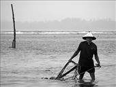 Fisherman out in the sea, while the rain is falling, but he has no choice.: by abroad, Views[98]