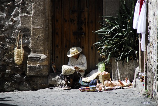 Artisans and Lovers. This artisan found a place to do some work in the doorway of an old building. He has skills in various materials. A simple life, an honest days work.