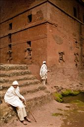 Elderly man rests at the foot of a rock hewn Church in Lalibela: by adam_lees, Views[287]