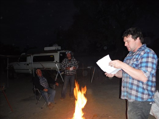 Dave on his 44th birthday reading poem he'd written.  Cooper Creek, Innamincka.