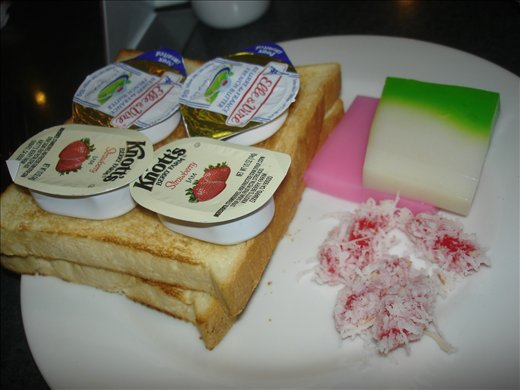 Yummy hotel breakfast with green & pink Indonesian cake.