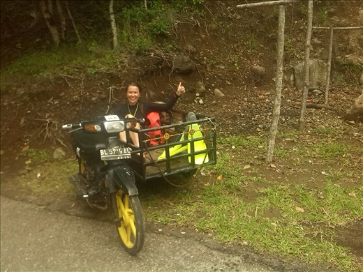 Running out of fuel in our uncomfy sidecar hitchhike!