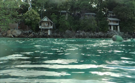 Dave snorkelling at Iboih, Sabang with bungalows in background.