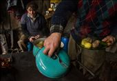 Meat and potatoes, a Patagonia staple of ranch life seen here on a plate, juxtaposed between the colorful lid of an old pot and the ranch laborers about to eat lunch.: by ahowdy, Views[509]