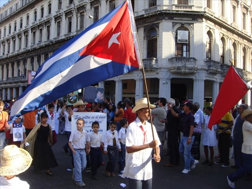 Pioneers of Cuban communism proudly parading with their flag