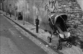 PRAM BARK, Perpignan, France: An empty pram adds a ghostly and deserted post apocalyptic feeling to the already depressing streets. Capping off the sadness, we see stray dogs chained to polls, with no owners in site. : by alexswinburn, Views[141]