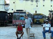 Men working in a parking of old and useless bus in La Habana.: by aliciafabregas, Views[234]