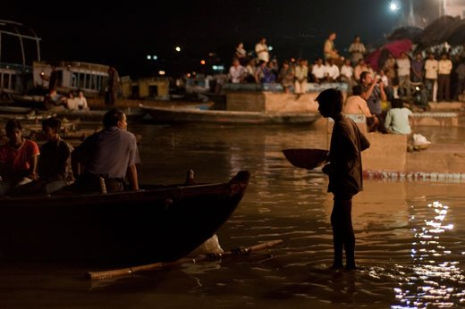 """Hello, sir, hello! You buy this to remember your father, your mother, your brother, your sister. I have fire. You put in the water…"" the boy pitches. ""Only five Rupee,"" he recites what seems to be the mantra for Varanasi's omnipresent invisible children."