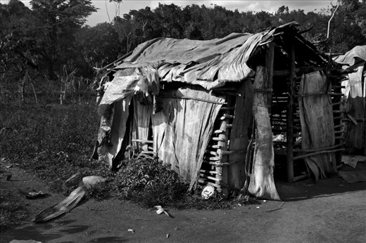 """Two years ago I went to a very small town named """"Tuningo"""" in the east side of the Dominican Republic, along with a group of volunteers from the organization Techo (Un Techo Para Mi Pais). The situation in this particular village was unbelievable. This picture represents the reality of my country, the side which is rarely shown and barely acknowledged by those of us, lucky enough to belong to a blind 2% of the population."""
