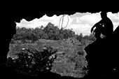 Being as their roofs consist mostly of dry leaves, every time it rains the families of Tuningo are forced to climb up a dangerous path to a cave in order to keep their children dry. In this picture, my partner and I climbed up to see for ourselves what it was like. It was a sunny day in Tuningo, the earth was dry, I almost fell down.: by alinaep, Views[286]