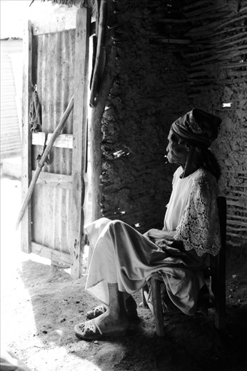 It's true that these circumstances are rough on children, who are forced to grow and endure work at a very early age. But it is especially hard on the elderly, like this woman who at the time I shot this picture was 112 years old. Abandoned by her family, there isn't much for her to do but to watch life pass her by.