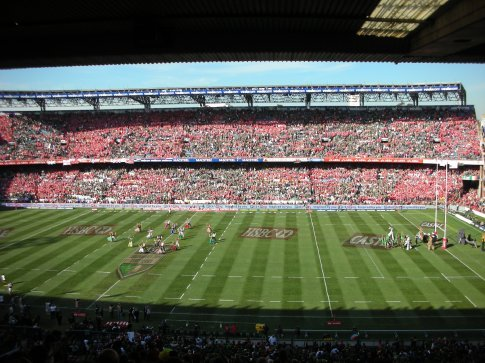 The sea of red British and Irish Lions jerseys in the stands opposite.