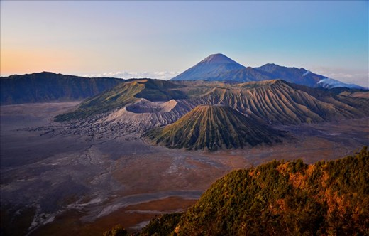 Bromo, an active volcano in East Java, Indonesia, is one of the most well-known tourist attractions in the country. The beautiful landscape encapsulates three mountains: Bromo (the crater), Batok (in the middle), and Semeru (the highest peak).