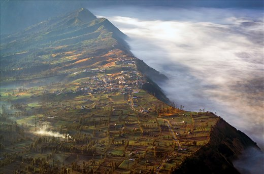 Right next to the volcano, tourists can see the beauty of Ngantang village, where the people of Tengger reside, still covered by the early morning mist. The farming patterns are lit beautifully by the golden morning ray.