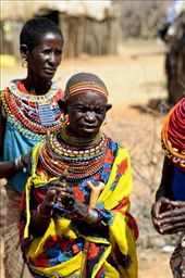 An elderly female of the tribe despite her age participates in welcoming us to their village.: by allann, Views[370]