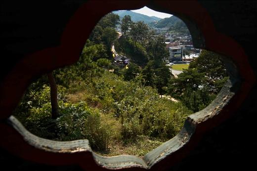 Baekje Fortress through a temple window