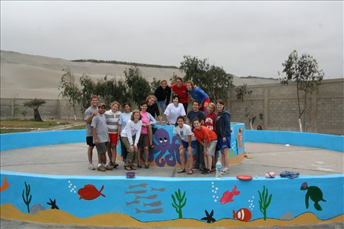 one morning the VBS team painted a fountain at the orphanage.  Great Job!