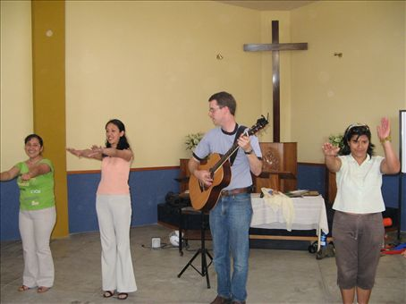 The Peruvian women then taught us a camp song accompanied by Allen.
