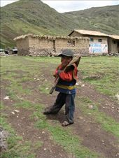 I bought marbles at the Calca market for the boys and stickers for the girls.  This little boy came running up to me for his treat.  He was on his way to the potato field to work--with his minature shovel on his back.  But oh so happy!!: by alleen, Views[167]