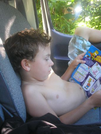 Jett's addicted to Simpson's magazines at the moment... Here he is in the van...