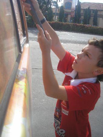 Jett happily cleaning the ambassador van..
