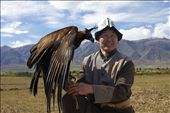 Man holds eagle in apprehension of releasing the blinders.: by alofachild, Views[302]