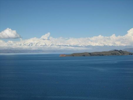The distant Andes, as seen over the expanse of Lake Titicaca.