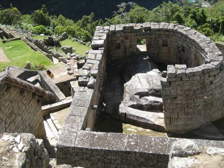 Looking down on the Temple of the Sun, the only circular structure at Machu Picchu.