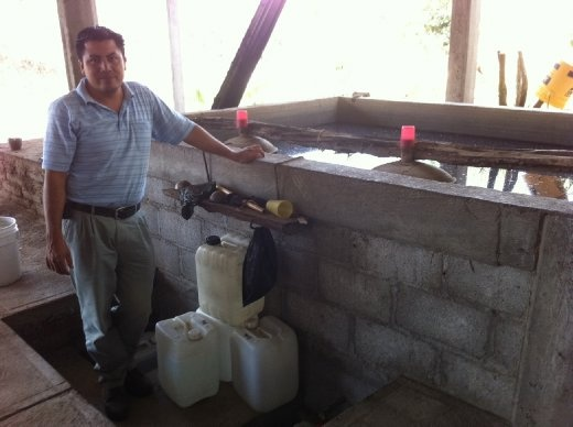 This is where distilled mezcal leaves the cold-water-cooled basin to fill lovely plastic jugs with fire water.