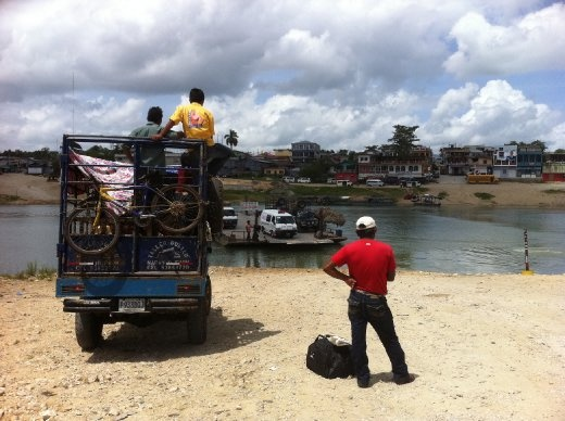 Awaiting the ferry to cross the unexpected river on the road south from Flores.