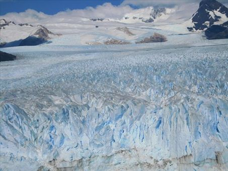 The glaciar is about 150 feet high above the water, and goes down another 300 feet below the surface of the lake to meet the valley floor.