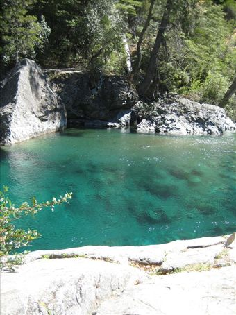 Swimming hole in the Rio Azul outside of El Bolson. Cold water with rainbow trout swimming everywhere!