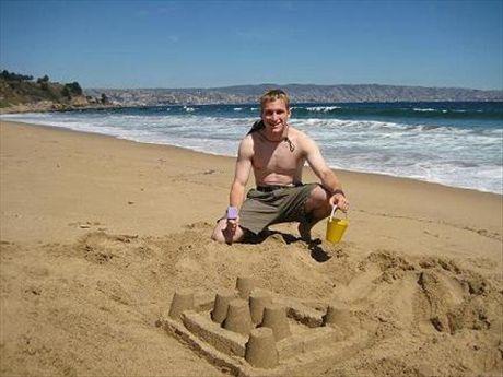 Kyle built a sandcastle in Viña del Mar. Doesn't he look proud!