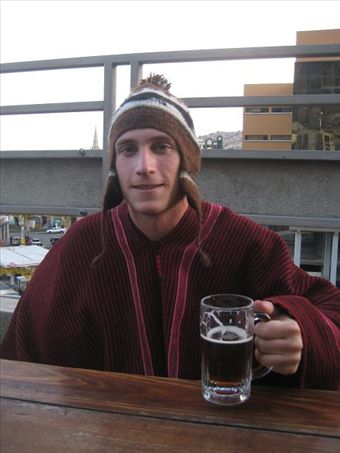 Kyle modeling his new poncho and hat while drinking a microbrew in La Paz.