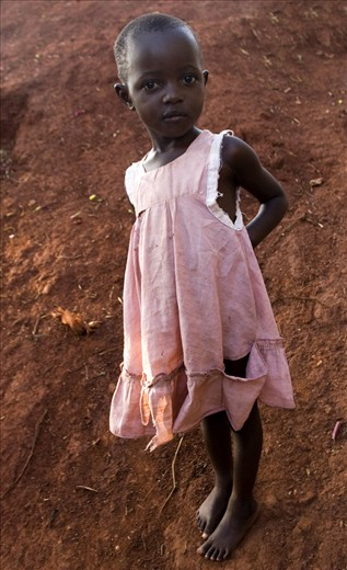Barefoot girl with torn dress , I met her on a walk in Uganda, Africa.