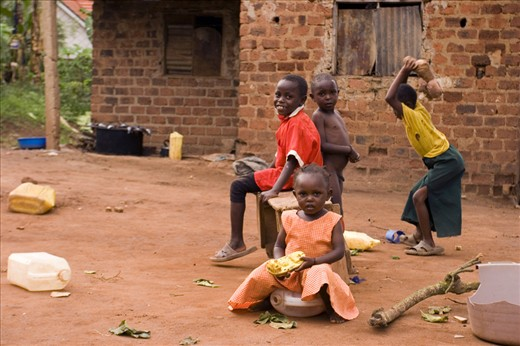 Children playing outside their home, Kampala Uganda