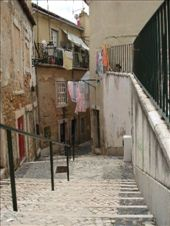 I love the crazy, winding streets in Lisbon. I love that nobody has a dryer and everyone has clothes on the line all the time. : by alysandjess, Views[307]