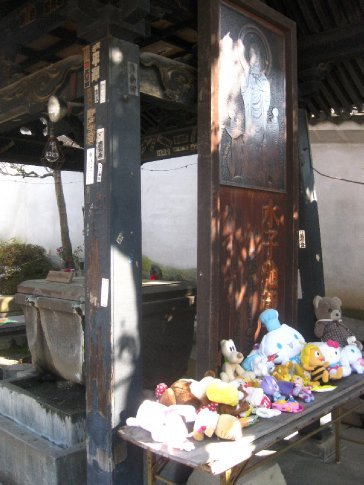 A shrine to Mizuko Jizo, patron saint of aborted and stillborn babies. People leave offerings of little dolls and toys around the base  :(