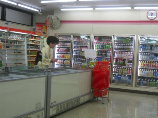 A Kimono browsing frozen goods in 7-11 ...this will never wear thin
