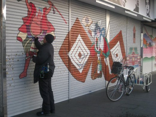 Artist Katori Senko working on his latest shutter art.
