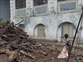 Boy picking up the wood they use to burn the bodies at one of the burning ghats: by amytaylor, Views[179]