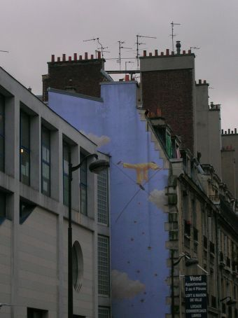 painted walls in the ghetto area of paris - french government commissioned artists to paint them