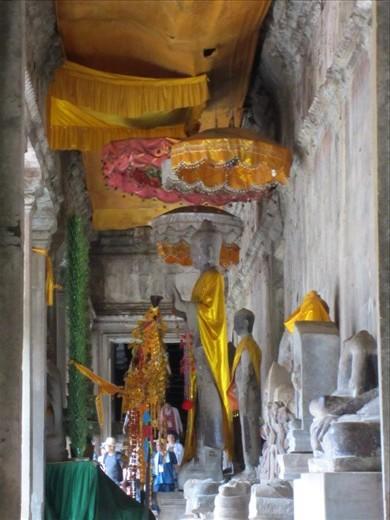 ornate Buddha inside Angkor Wat.