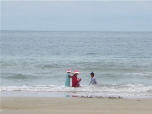 except for a few locals.  these kids were having so much fun.  however, it is so odd to see them swimming fully clothed.